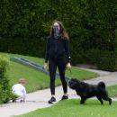 Troian Bellisario – Out for a walk with her dog in Los Angeles - 454 x 382