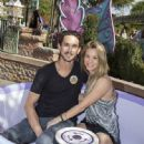 Ryan Sweeting and actress Kaley Cuoco Sweeting take a ride on The Mad Tea Party attraction at Disneyland on February 15, 2014 in Anaheim, California - 447 x 594