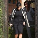 Kim Kardashian: stepped out of her Beverly Hills home and hopped into a chauffeured car