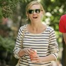 An Unusually Cheerful Kirsten Dunst Enjoys A Luncheon With A Friend At Sant Ambroeus Restaurant In The West Village, New York City, 2008-07-02