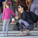 Adriana Lima in Tights shopping by the beach in Miami