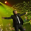 Jon Bon Jovi performs onstage at the Songwriters Hall of Fame 45th Annual Induction and Awards at Marriott Marquis Theater on June 12, 2014 in New York City