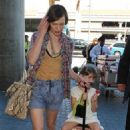 Milla Jovovich's Family-Filled Tokyo Take-Off