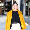 Lana Condor – In a yellow coat posing while out in NYC - 454 x 563