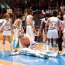 "Woody Harrelson (left) stars as ""Ed Monix"", Andy Richter (center) as the Tropic's manager ""Bobby Dee"", Will Ferrell (center floor) as an unconscious ""Jackie Moon"" and Peter Cornell (right) as ""Vakidis"""