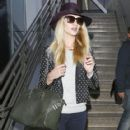 Rosie Huntington-Whiteley arriving on a flight at LAX in Los Angeles, California on April 18, 2014