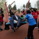 Prince Harry enjoys mixing with local school children from Gainsborough Primary school in Newham at the new Queen Elizabeth Olympic Park, with the Mayor of London, Boris Johnson. The park will open to the public