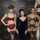Dita Von Teese attends a photocall to launch her new lingerie range at Debenhams on November 28, 2012 in London, England - 395 x 594