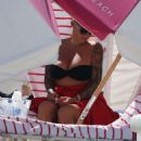 Amber Rose in Black Bikini on the beach in Miami - 454 x 588