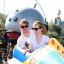Emma Roberts and boyfriend Chord Overstreet take a spin on the Astro Orbitor attraction at Disneyland on Monday (August 15) in Anaheim, Calif