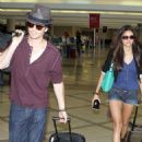 Nina Dobrev and her boyfriend, Ian Somerhalder departed from Los Angeles International Airport yesterday, August 8