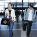 Cody Simpson seen Departing LAX with his Girlfriend December 28, 2014 - 454 x 588