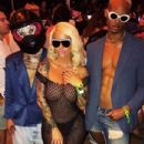 Amber Rose and The Migos at at the Coachella Valley Music And Arts Festival in Indio, California - April 17, 2017 - 434 x 539