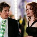 Alicia Witt and Hugh Grant