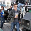 """Christina Aguilera holds onto Cam Gigandet while filming a scene atop a Triumph motorcycle for their upcoming film """"Burlesque"""""""