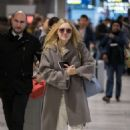 Dakota Fanning – Arrives at Charles de Gaulle Airport in Paris