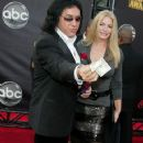 Gene Simmons and Shannon Tweed arrives at the 2007 American Music Awards held at the Nokia Theatre L.A. LIVE on November 18, 2007 in Los Angeles, California - 359 x 594