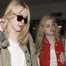 Dakota and her little sister, Elle, landed at Los Angeles International Airport last night, May 3