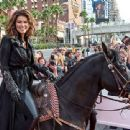 Talk about making an entrance! The singer arrives on horseback Wednesday to mark her residency at Caesars Palace in Las Vegas, where she'll be performing in Shania: Still the One - 454 x 340