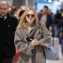 Dakota Fanning – Arrives at Charles de Gaulle Airport in Paris