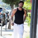 Maksim Chmerkovskiy stops by Hammer & Nails, a nail salon for men, in West Hollywood, California on August 7, 2014 - 421 x 594