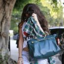 Selena Gomez got her hair chemically straightened today at a hair salon in West Hollywood, California on July 19, 2013 - 454 x 636