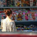 Jennifer Love Hewitt and her assistant spend Wednesday morning at the newsstand