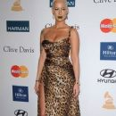 Amber Rose and Wiz Khalifa  arrive at Clive Davis and the Recording Academy's 2012 Pre-GRAMMY Gala and Salute to Industry Icons Honoring Richard Branson held at The Beverly Hilton Hotel in Beverly Hills, California - February 11, 2012 - 372 x 594