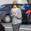 Kourtney Kardashian, wearing sunglasses and a brown fedora, is spotted entering an office building in Los Angeles