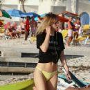 Suki Waterhouse in Bikini Bottoms on the beach in Barbados December 24, 2016