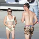 Emma Roberts in Yellow Bikini on the beach in Punta Mita