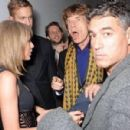 Taylor Swift, Calvin Harris and Sir Mick Jagger attend the Universal Music Brits party hosted by Bacardi at The Soho House Pop-Up on February 25, 2015 in London, England.