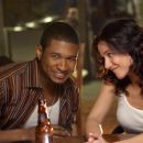 Usher Raymond and Emmanuelle Chriqui