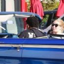 Nick Young and his rapper girlfriend Iggy Azelea ride in style to grab some Chick-fil-A in Los Angeles California on December 23, 2014 - 454 x 307
