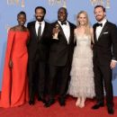 (L-R) Actors Lupita Nyong'o and Chiwetel Ejiofor, director Steve McQueen, actors Sarah Paulson and Michael Fassbender, winners of Best Motion Picture - Drama for '12 Years a Slave,' pose in the press room during the 71st Annual Golden Globe Awards held at - 454 x 378