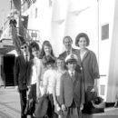 July 29th, 1963 - The Rt Hon Sir David Ormsby-Gore KCMG went aboard the Queen Mary on her arrival today at Southhampton with his children Julian (22, dark glasses), Jane (20) and Victoria (16) to meet his wife Lady Ormsby-Gore, daughter Alice (11, with co - 454 x 412