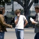 Billy Crudup and Patrick Fugit go over a scene with writer/director/producer Cameron Crowe on the set of Dreamworks' Almost Famous - 2000