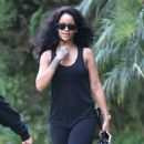 Something to smile about? Rihanna steps out in skin-tight workout leggings amid rumours of a romance with Leonardo DiCaprio
