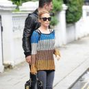 Pop Kylie Minogue is all smiles as she is seen heading to her management office in London