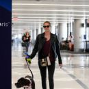 Kate Upton with her dog Harley catches a flight in NY