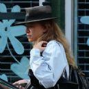 Mary Kate Olsen Leaves Her Home In New York