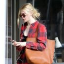 Elle Fanning–Hits the gym in LA