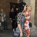 Katy Perry is all smiles as she makes her way out of a Broadway play with a friend in New York City