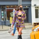 Irina Shayk – In a mini skirt in New York