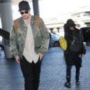 Robert Pattinson seen departing on a flight at LAX airport in Los Angeles, California on October 3, 2016 - 438 x 600