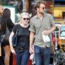 A smitten looking Dakota Fanning and her boyfriend Jamie Strachan go hand in hand for a stroll around New York City - 395 x 594