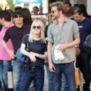 A smitten looking Dakota Fanning and her boyfriend Jamie Strachan go hand in hand for a stroll around New York City - 411 x 594