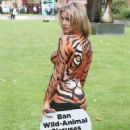 Joanna Krupa – Bodypaint while protesting outside Westminster in London - 454 x 613