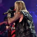 Musicians Nikki Sixx and Vince Neil of Motley Crue perform onstage during the 2014 iHeartRadio Music Festival at the MGM Grand Garden Arena on September 19, 2014 in Las Vegas, Nevada