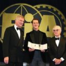 FIA President Max Mosley and FOM President Bernie Ecclestone present Michael Schumacher with the FIA Academy Gold Medal at the 2006 FIA Gala Prize Giving Ceremony held at the Salle des Etoiles Sporting Club on December 8, 2006 in Monte Carlo, Monaco